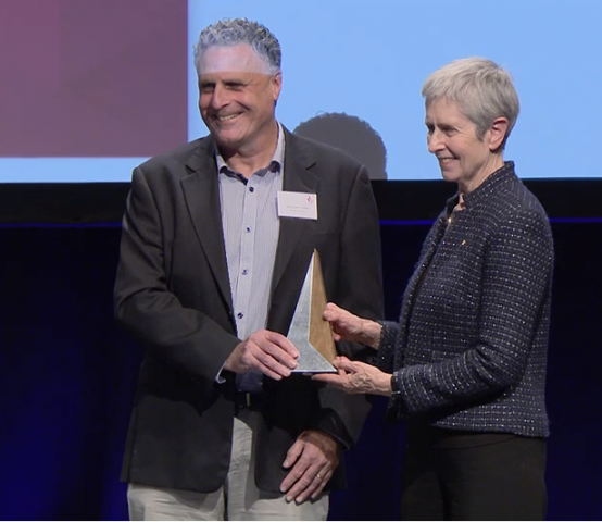 Prof Andrew Forbes receives Excellence in Trial Statistics award from Anne Kelso, NHMRC CEO